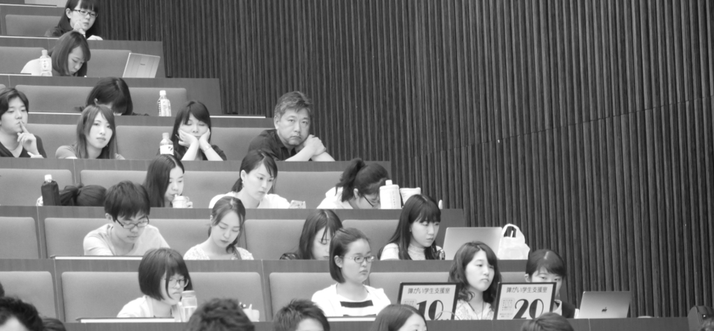 Hirokazu Kore-eda blends in with the crowd of students attending Claude Lelouch's master class