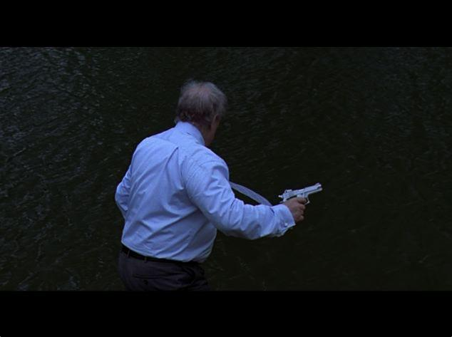 The Man on the Riverbank