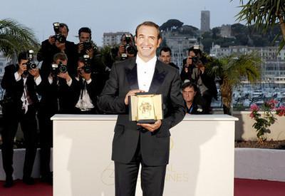 Maïwenn y Jean Dujardin en el Palmarés duel festival de Cannes 2011 - Jean Dujardin - Prix d'Interprétation Masculine - © Afp